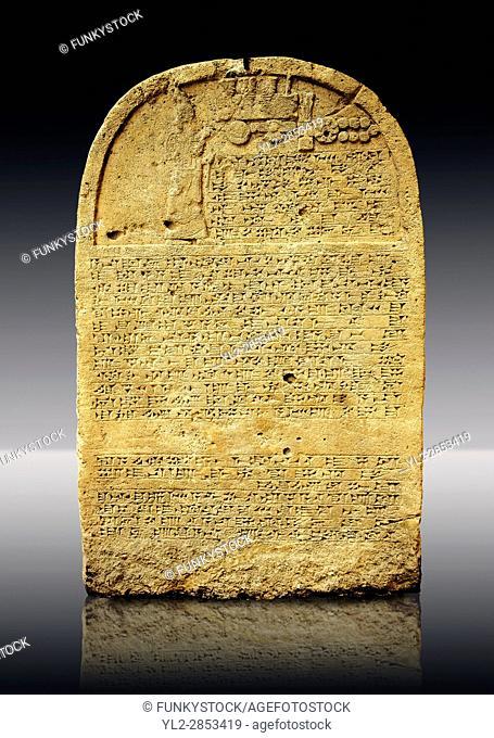 Limestone Sculpted relief Stele with inscription to King Sennacherib. The relief shows Assyrian King Sennacherib praying in front of divine symbols