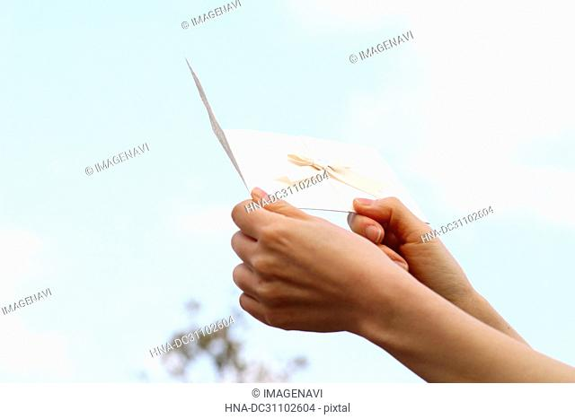 Woman Hand Holding Invitation Card