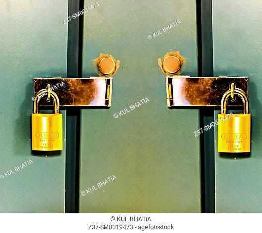 Two identical padlocks, side by side on a pair of lockers, Ontario, Canada