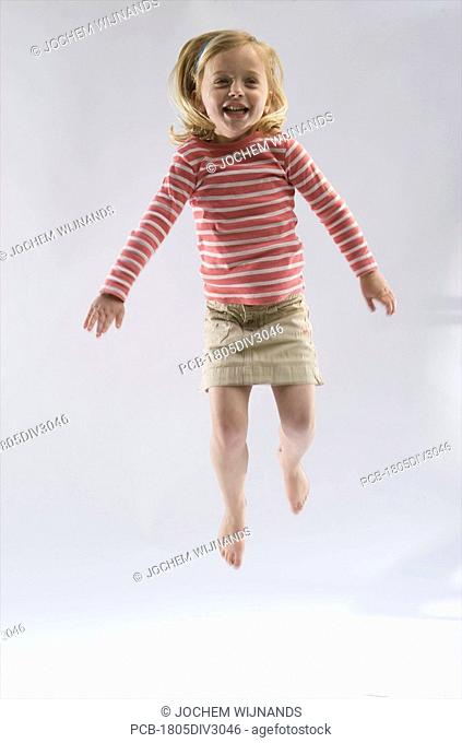 Four year old girl jumping