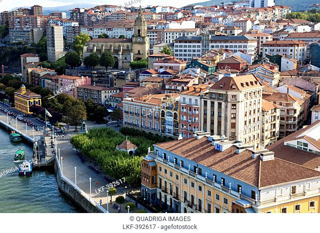 View Portugalete, walk out of the Puente Colgante, river Nervion, Bilbao, Basque Country, Spain