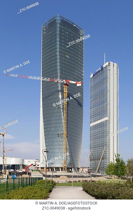 """Hadid Tower (called """"""""lo storto"""""""") under construction. On the right the Allianz Tower (called """"""""il dritto"""""""") designed by Isozaki. Milan, Italy"""