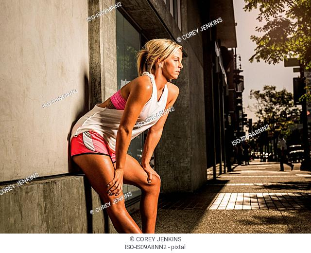 Female runner stopping to catch her breath