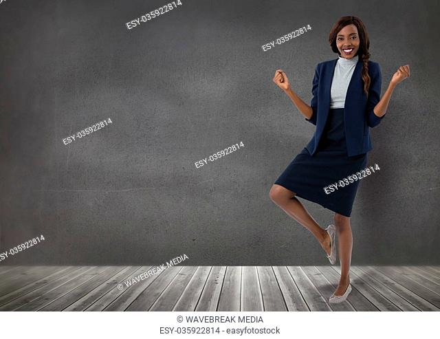Businesswoman standing on one leg in room