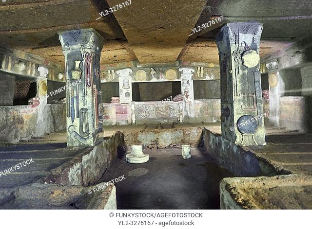 Interior of the Tomb of Reliefs that has everyday Etruscan objects carved into the volcanc Tuff rock, as well as separate burial chambers with rock pillows