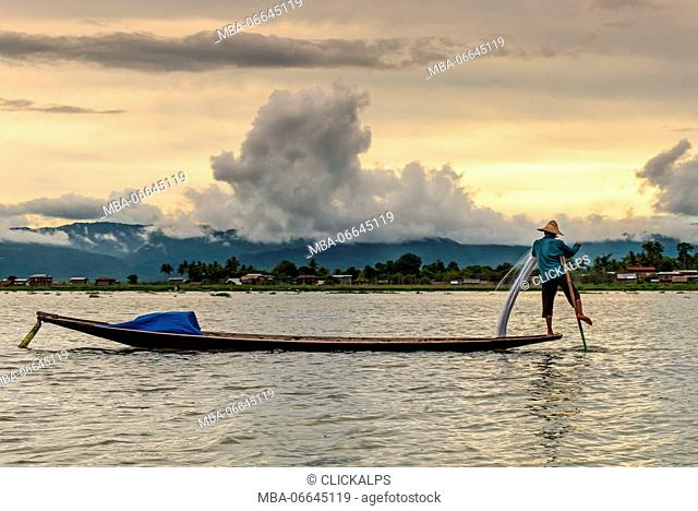 Inle Lake, Myanmar, South East Asia. A fisherman in balance on his canoe