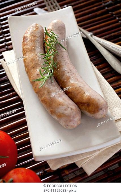 Two fried butifarra (fresh pork sausage, Catalonia)