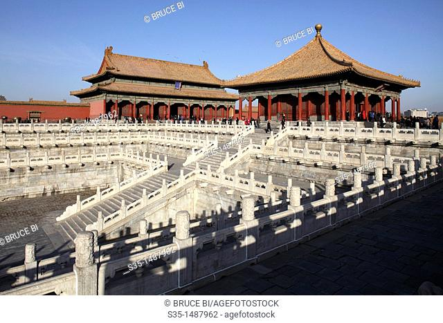 White marble railings with Hall of Central Harmony Zhong He Dian and Hall of Preserving Harmony Bao He Dian in the background  Forbidden City  Beijing  China