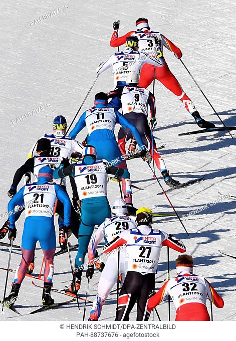 The athletes, lead by later winner Alex Harvey from Canada, in action during the men's 50 km mass start freestyle cross-country event at the Nordic Ski World...