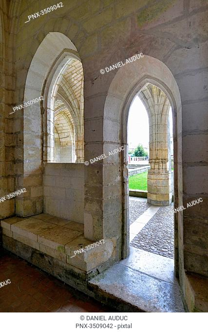 France, Dordogne, medieval door and window of the Abbey of Brantome. Cloister in the background