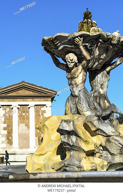 Triton's Fountain or Fontana dei Tritoni with Temple of Portunus (Temple of Fortuna Virilis) in Piazza della Bocca della Verita, Rome, Italy