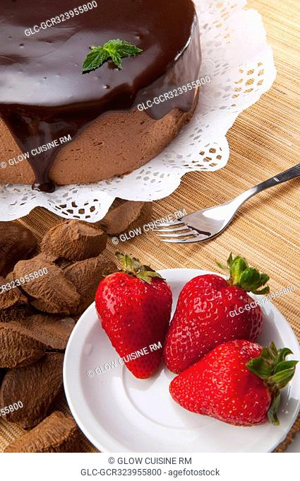 High angle view of chocolate cake and strawberries