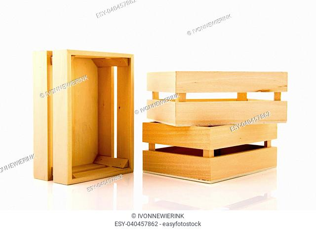 Empty wooden crates stacked and isolated over white background