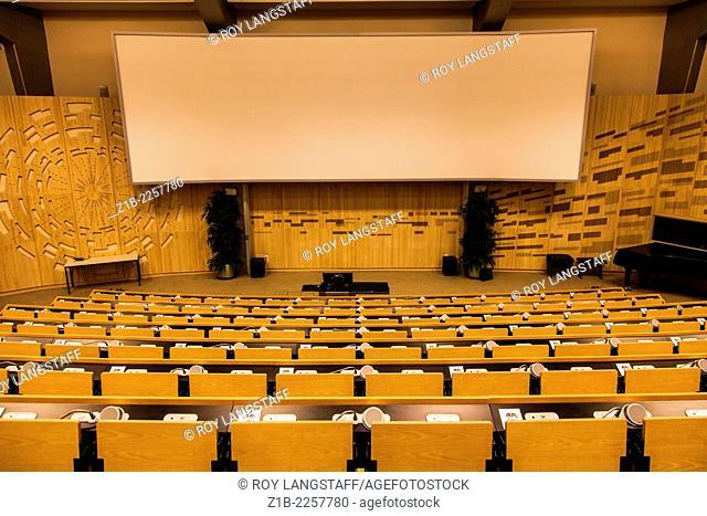 View of the podium and presentation screen in the main CERN auditorium, Geneva, Switzerland