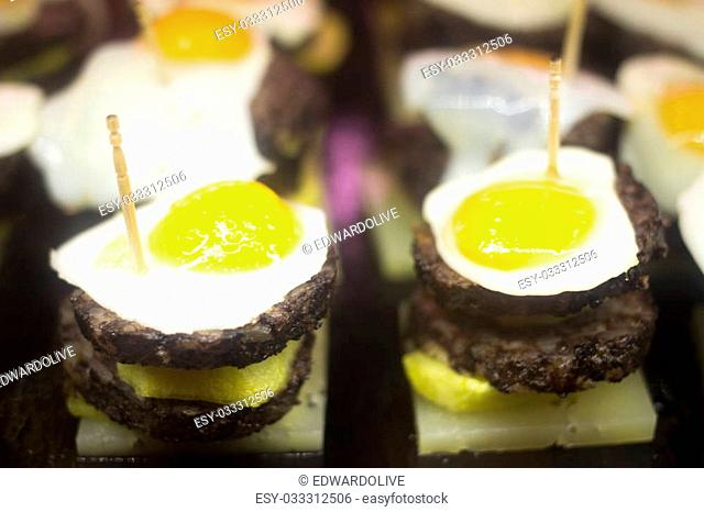 Spanish cusine tapas dishes in restaurant cafe pinchos of typical traditional prepared food in Andalusia Spain