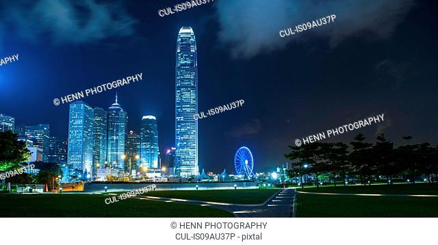 Sky line and ferris wheel illuminated at night, financial district, Hong Kong, China