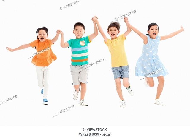 Cheerful school students hand in hand running