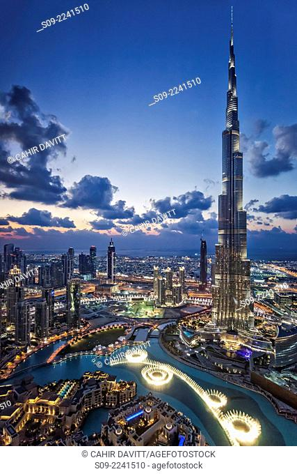 View from above of the Burj Khalifa (Armani Hotel) designed by Skidmore Owings and Merrill , the Souk Al Bahar and the Dubai Fountains at twilight, Business Bay