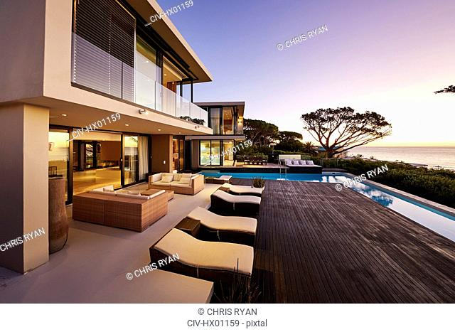 Modern luxury home showcase exterior with swimming pool and ocean view