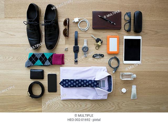 Still life business travel items on hardwood floor