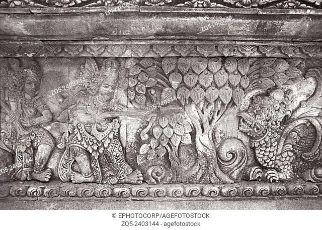 Singaraja temple, King accompanied with his attendant- killing a syncretic animal in the forest. Bali Indonesia