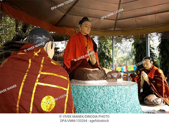 Statues of lord Buddha and his disciples at Dhamma chakka pavattana sutta wheel of law at Sarnath ; Varanasi ; Uttar Pradesh ; India