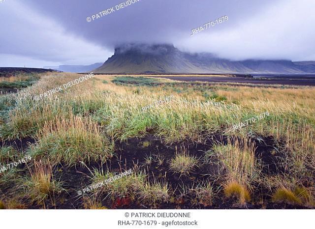 Mount Lomagnupur, 767 m, near Nupsstadur is a remarkable landmark above the flat black sand expanses of Skeidararsandur, south-east Iceland Austurland, Iceland