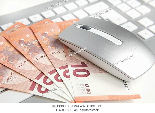 50 euro banknotes on keyboard and mouse