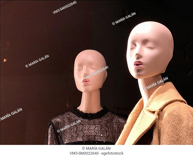 Two mannequins in a shop window