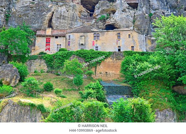 A fortified cave house, occupied from prehistoric times, built into caves in a cliff. Located in the Perigord region of France