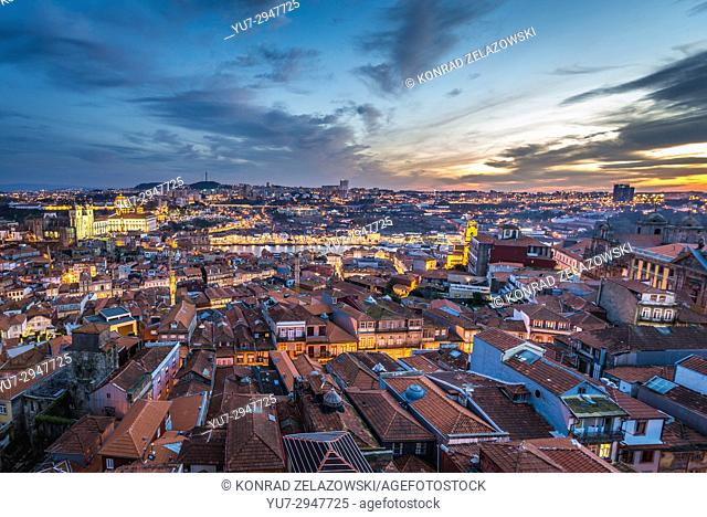 Evening in Porto, second largest city in Portugal. Aerial view from bell tower of Clerigos Church with Se Cathedral and Vila Nova de Gaia city