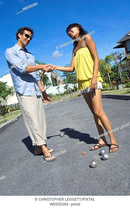young couple shaking hands