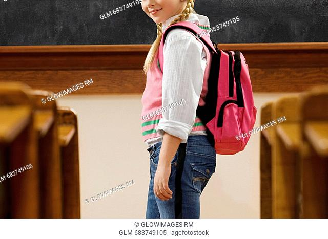 Girl standing in a classroom
