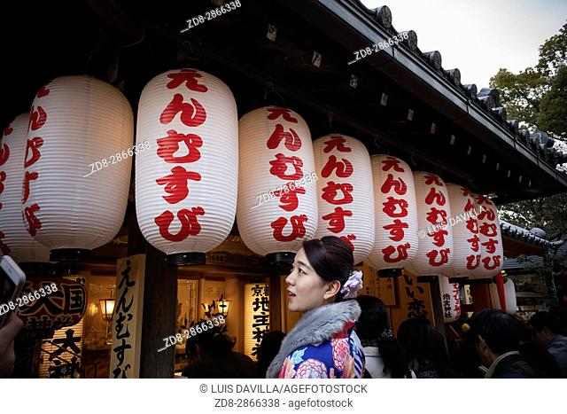women with japanese prayer lanterns