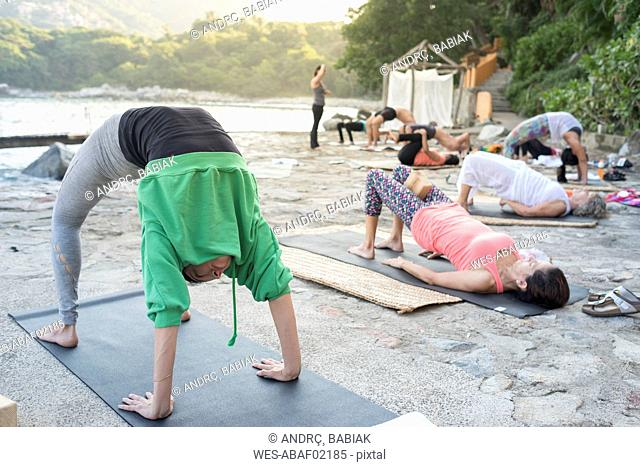 Mexico, Mismaloya, yoga class at ocean front