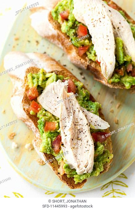 Toast with avocado and chicken (seen from above)