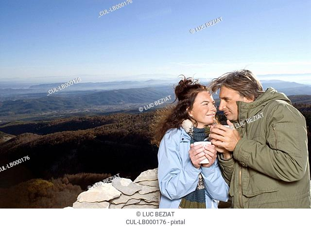 Couple having a hot drink
