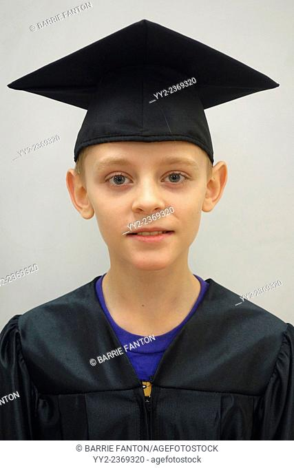 6th Grade Boy in Cap and Gown, Wellsville, New York, United States