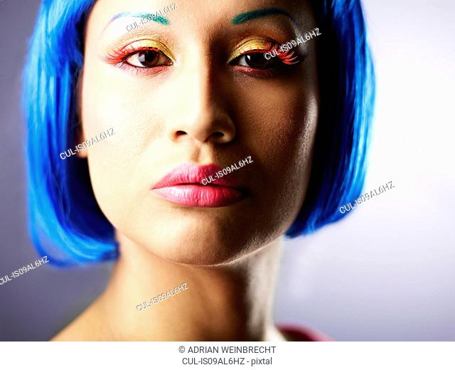 Young woman with dyed blue hair