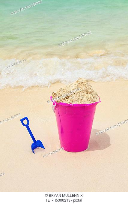 Sand pail and shovel on beach