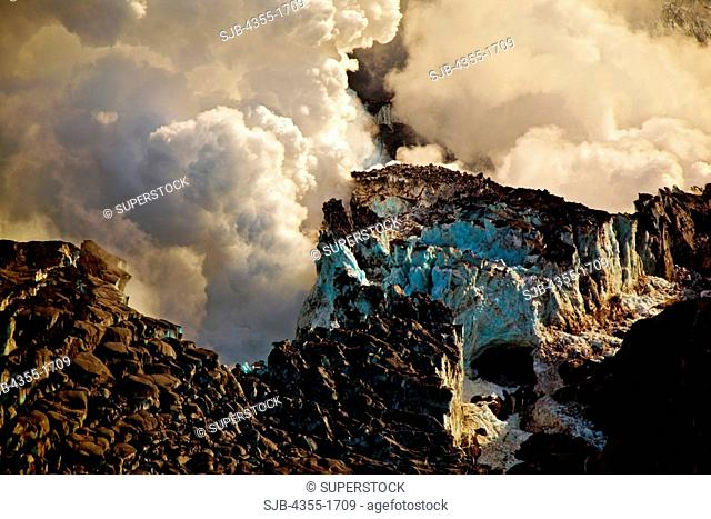 Steaming craters and an explosion during the Eyjafjallajokull volcanic eruption on Mt. Eyjafjoll in Iceland. Lava broke through the Gigjokull Glacier