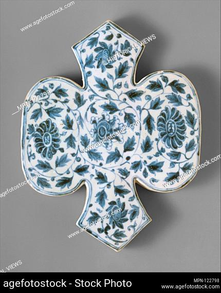 Shaped Tile with Floral Decoration. Date: 15th century; Culture: Vietnam; Medium: Porcelain with underglaze blue decoration; Dimensions: H. 13 in