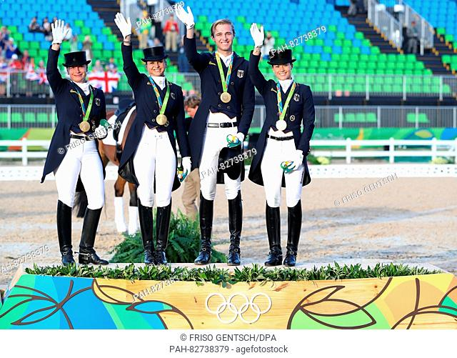 (L-R) Isabell Werth, Dorothee Schneider, Soenke Rothenberger and Kristina Broering-Sprehe of Germany celebrate on the podium during the victory ceremony after...