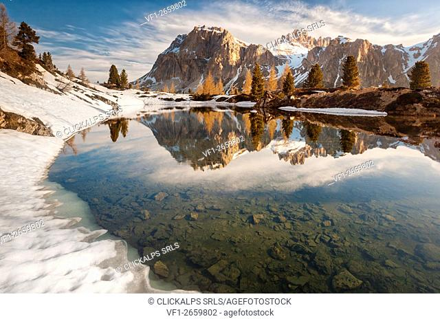 The alpine lake Limedes in a spring morning with the mounts Lagazuoi and Fanis reflcted, Dolomites, Belluno, Italy