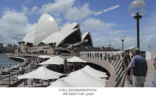 Sydney Australia close up of famous Sydney Opera House restaurant with umbrellas and tourists in New South Wales