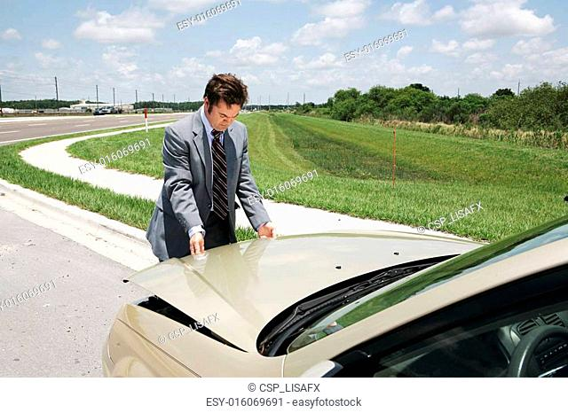 Businessman Checking Under Hood