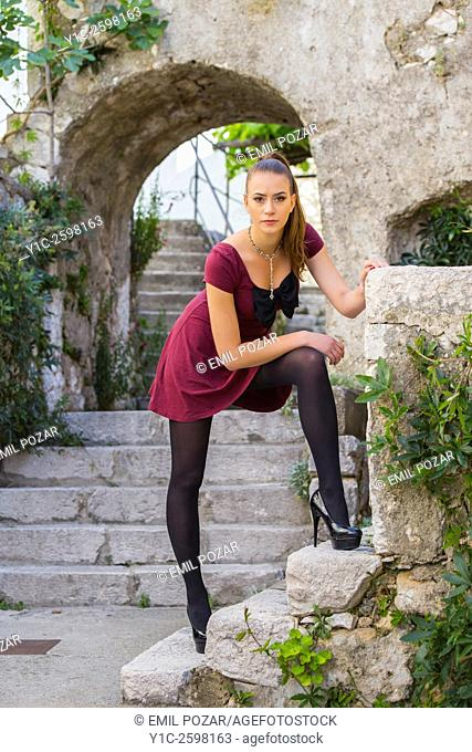 Beautiful young woman posing in Mediterranean old town