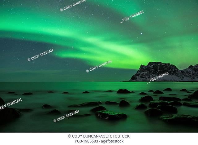Aurora Borealis - Northern Lights over sea at Utakleiv, Vestvågøy, Lofoten Islands, Norway