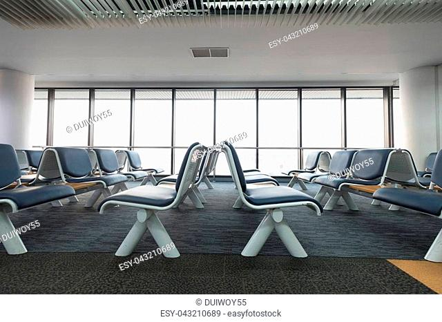 Empty airport terminal waiting area with chairs lounge with seats in the airport