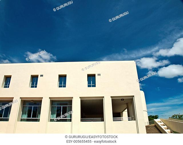 Facade windows of office building on blue sky